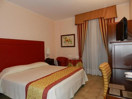 A bed or beds in a room at Hotel Il Mulino