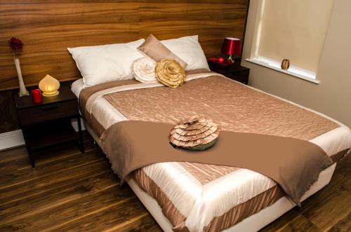 A bed or beds in a room at Trivelles Liverpool