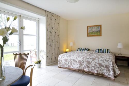 Ein Bett oder Betten in einem Zimmer der Unterkunft B&B Tiendegaarden Møn