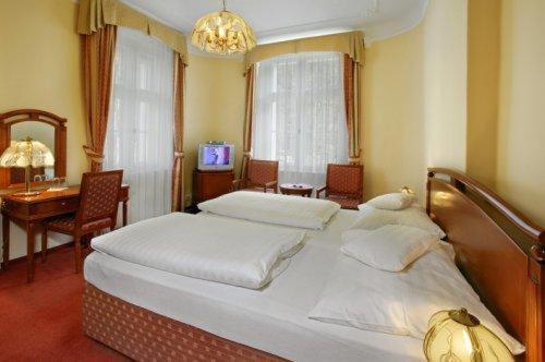 Postel nebo postele na pokoji v ubytování Hotel Saint Antonius