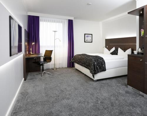 Ein Bett oder Betten in einem Zimmer der Unterkunft Central Hotel