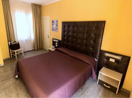 Ein Bett oder Betten in einem Zimmer der Unterkunft Albergo Italia