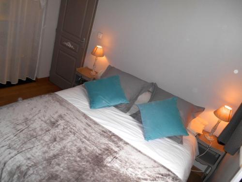 Un ou plusieurs lits dans un hébergement de l'établissement Cat'Appart