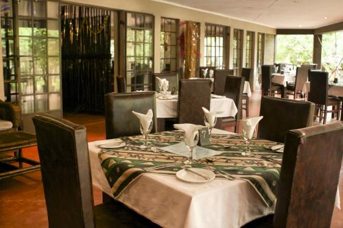 A restaurant or other place to eat at Woodlands Lilongwe