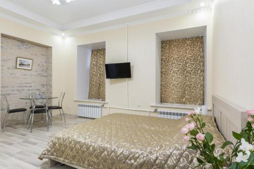 Кровать или кровати в номере Апартаменты на Конюшенном