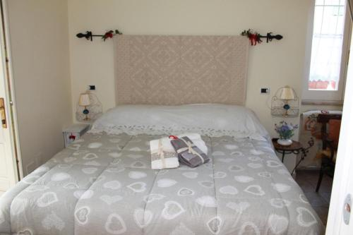 A bed or beds in a room at Da Agnese Locazioni brevi