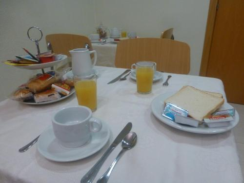 Breakfast options available to guests at Hostal El Val
