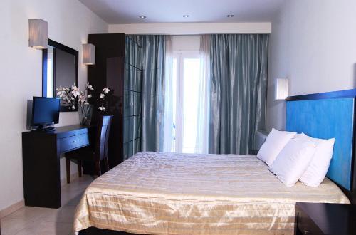 Ένα ή περισσότερα κρεβάτια σε δωμάτιο στο Ακταίον