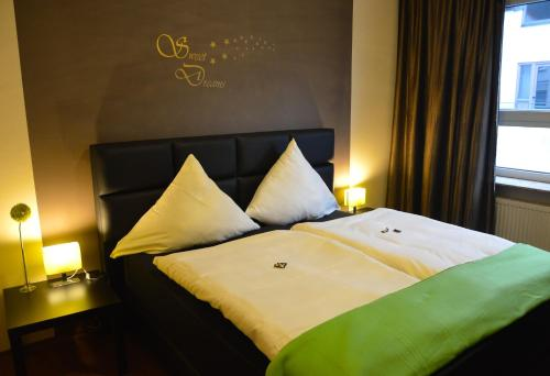 A bed or beds in a room at Hotel Haus Krone