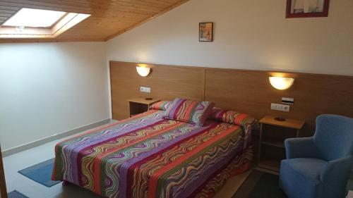 Cama o camas de una habitación en Hotel Valdoviño