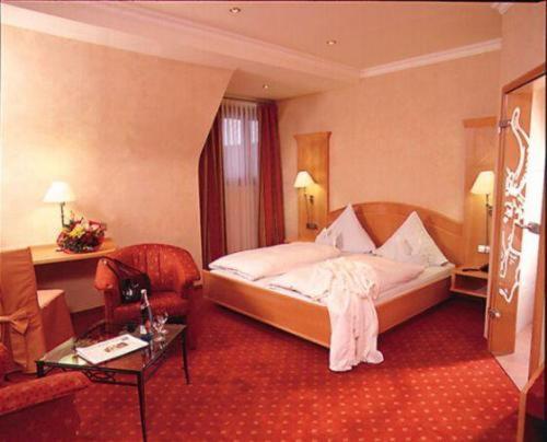 Ein Bett oder Betten in einem Zimmer der Unterkunft Hotel Restaurant Ochsenwirtshof