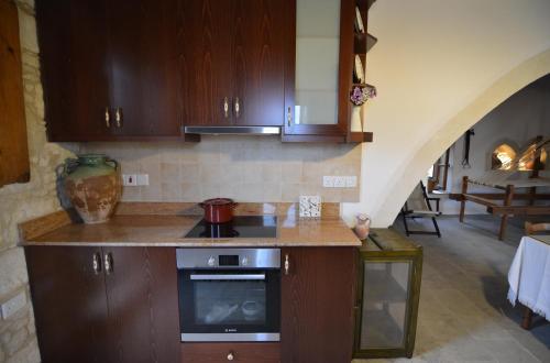 A kitchen or kitchenette at Aliki's House 1+ 2