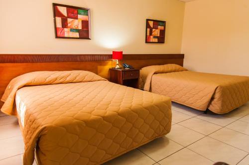 Cama o camas de una habitación en Hotel Estrella