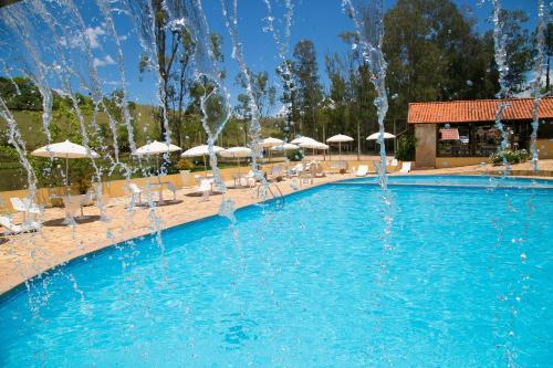 The swimming pool at or near Hotel Fazenda Vista Alegre