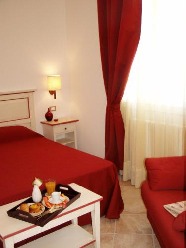 A bed or beds in a room at Alla Corte Del Picchio Room & Breakfast