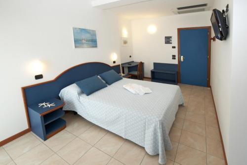 Un ou plusieurs lits dans un hébergement de l'établissement Hotel Torretta