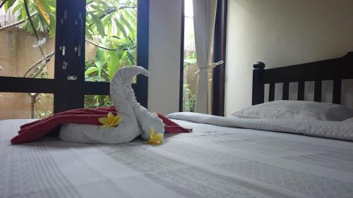 A bed or beds in a room at Praschita Bali