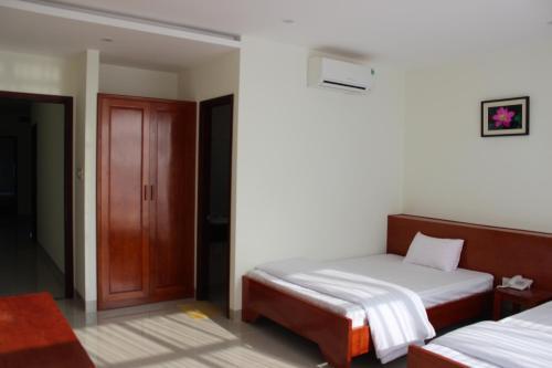 Giường trong phòng chung tại Seastar Hotel Danang