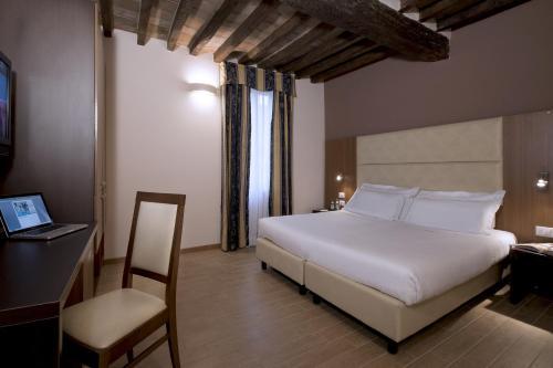 Letto o letti in una camera di CDH Hotel Villa Ducale