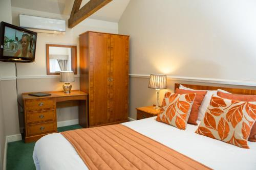 A bed or beds in a room at The Peel Aldergate