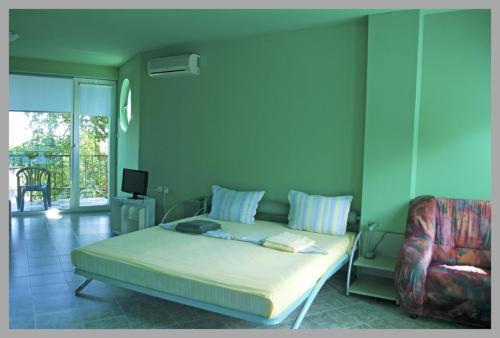 A bed or beds in a room at The Colourful Mansion Hotel