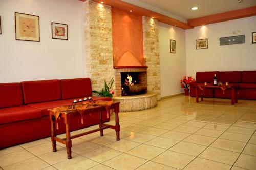 A seating area at Haris Apartments