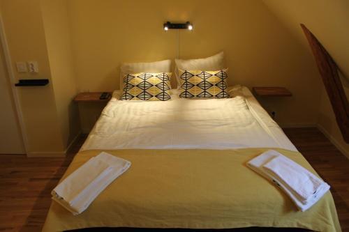 Säng eller sängar i ett rum på Magles Smiley Inn