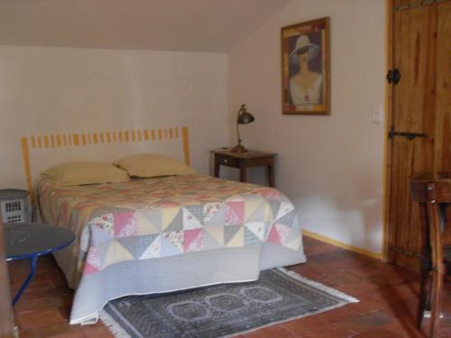 A bed or beds in a room at Chambre d'hôtes Les Bienvenus