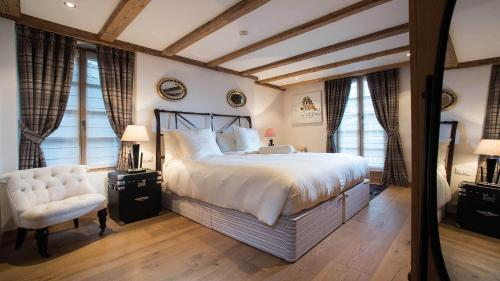 A bed or beds in a room at Hotel Olden
