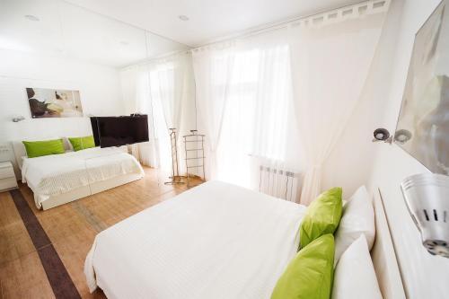 Кровать или кровати в номере Гостиница «Призма»