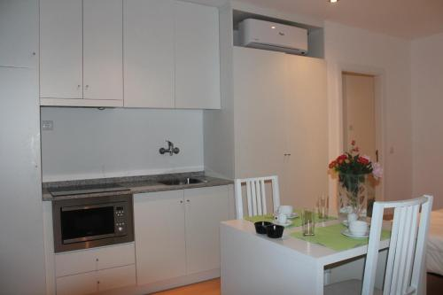 A kitchen or kitchenette at Apartments Villas 4Ever