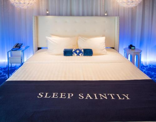 A bed or beds in a room at The Saint Hotel Key West, Autograph Collection