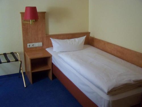 Ein Bett oder Betten in einem Zimmer der Unterkunft Hotel Gerber