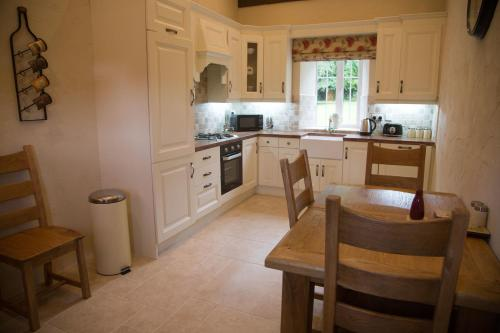 A kitchen or kitchenette at Ardagh Suites Self Catering