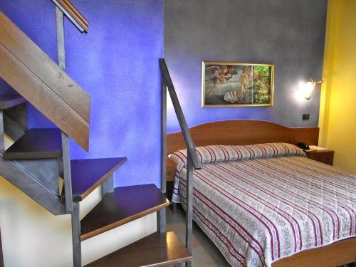 A bed or beds in a room at Hotel Duca Della Corgna