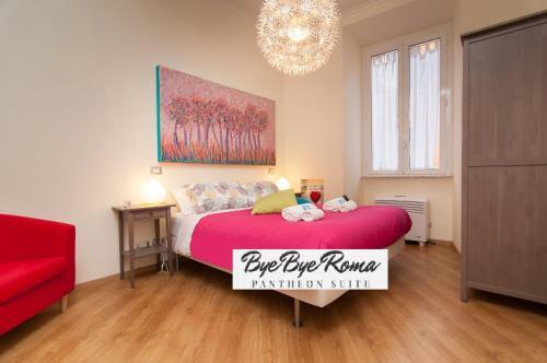 Un ou plusieurs lits dans un hébergement de l'établissement Bye Bye Roma Pantheon Suite