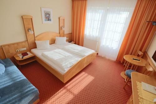 Ein Bett oder Betten in einem Zimmer der Unterkunft Panoramahof Ziegler