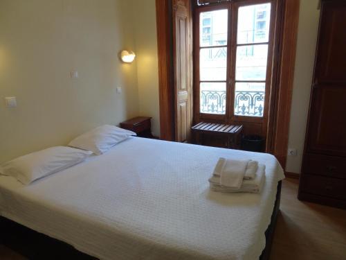 En eller flere senge i et værelse på Norte Guest House