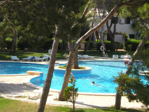 The swimming pool at or near Apartamentos Las Brisas I & II