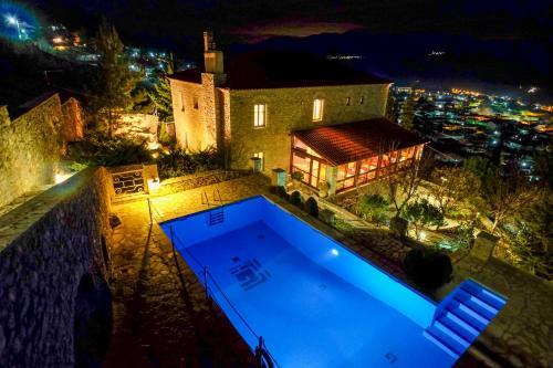 Θέα της πισίνας από το Kyriaki Guesthouse ή από εκεί κοντά