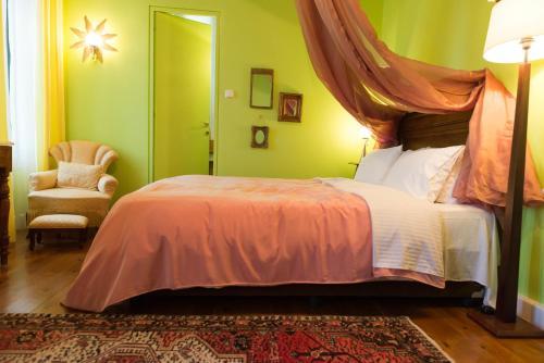 Ένα ή περισσότερα κρεβάτια σε δωμάτιο στο Αρχοντικό Βογιατζόπουλου