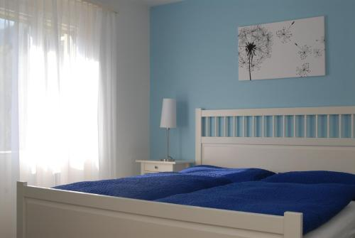 Ein Bett oder Betten in einem Zimmer der Unterkunft Hotel Alphorn