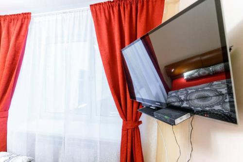 Телевизор и/или развлекательный центр в BatmanHome Apartment