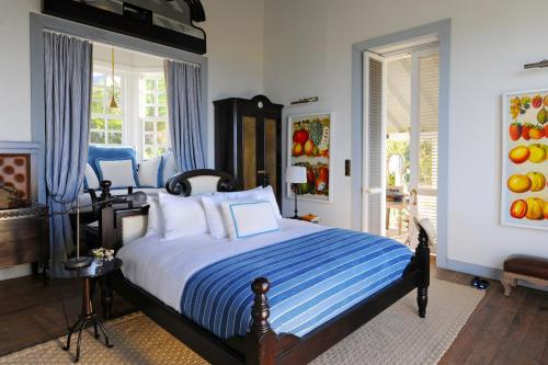 A bed or beds in a room at Belle Mont Farm - Kittitian Hill