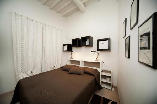 Cama o camas de una habitación en Roommo Central Florence - San Gallo