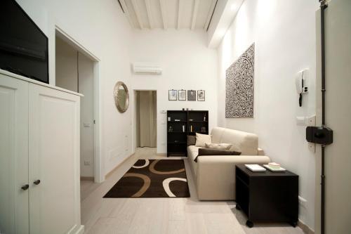 Zona de estar de Roommo Central Florence - San Gallo