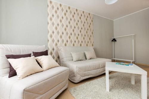A seating area at Likhachevskoye Sheremetyevo Apartment