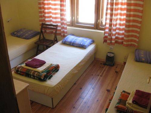 A bed or beds in a room at Hostel Mostel