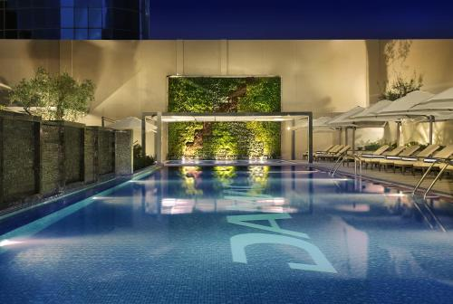The swimming pool at or near DAMAC Maison Cour Jardin