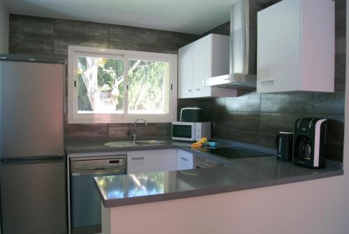 Una cocina o zona de cocina en Pomera I - BTB